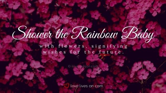 Shower the rainbow baby with flowers